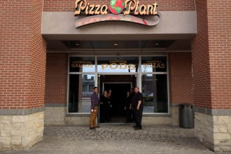 People standing in front of the new Pizza Plant Canalside