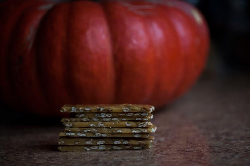 Pumpkin Seed Brittle -  Roasted pumpkin seeds enveloped in caramel
