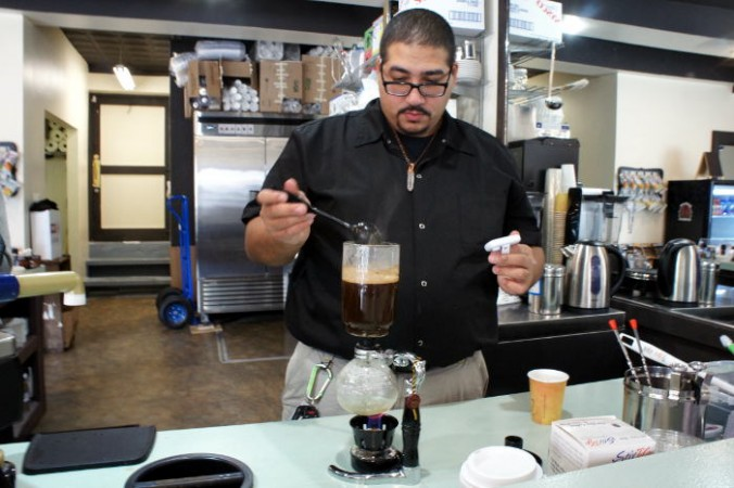Owner Hamada Saleh making Siphon Coffee / Step Out Buffalo