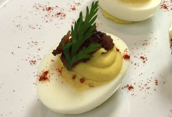 Spiced Bacon Jam Deviled Egg, one of three served