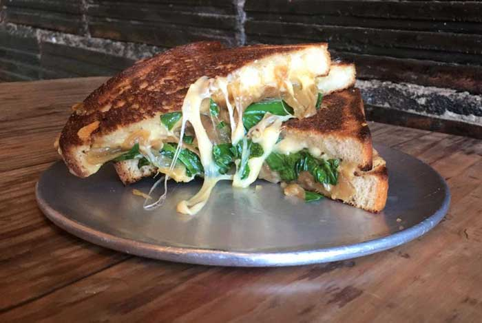 Eat a cheesy sandwich to warm you up on a cold day in Buffalo. Grab one from the Buffalo Melting Pot