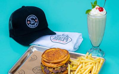 Enter to Win  a Dinner for 2, $25 Gift Certificate, T-Shirt, & Trucker Hat from Mister Sizzle's